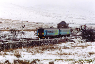 Another class 2 local train, 2H92 1449 Leeds to Carlisle, passes the 'box and down starter into the 8 miles section to Garsdale.