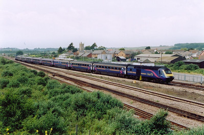 A more side on view of an up HST with powercars 43138 and 43144 rostered to 1L55 1130 from Swansea to Paddington.  The scrubland in the foreground was once a mass of sidings forming part of the huge yards here.