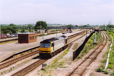 With the numbers of class 60s being stored getting higher and the working fleet getting less and less, it is always good to see a tug even if it is running light.  66028 heads west with an unknown movement.