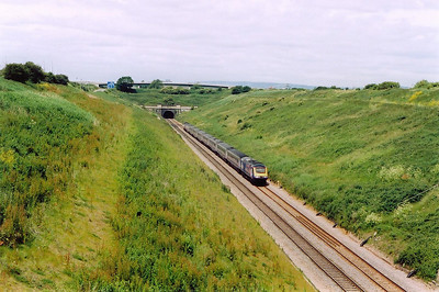 A wide angle shot of the vast cutting which shows the amount of spoil that had to be removed before the required depth was reached and the tunnel proper was started.  430090 and 43139 powers 1L52 1030 Swansea to Paddington.