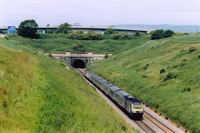 Over on the English side of the River Severn and I have located the English portal.  An unknown HST forms a down service, 1B20 0945 Paddington to Swansea, and drops down the 1 in 100 grade and approaches the blackness of the 4 mile 628 yard long Severn Tunnel.