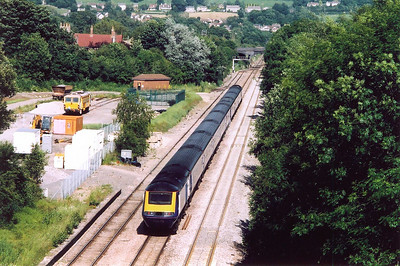 From the high bridge with tall parapets which require a step ladder to see over, an unknown HST climbs the steady 1 in 300 grade passing the site of Chipping Sodbury station.  In the yard is OTP 73925 which I saw at Coalpit Heath.  The up train is 1L76 1530 Swansea to Paddington.