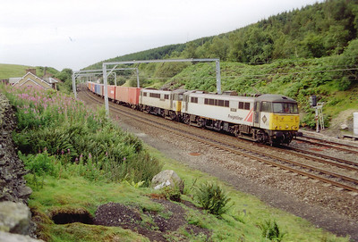 An up Freightliner working passes the level section of the summit with 86628 and 86615 working 4L60 1500 Coatbridge to Ipswich.