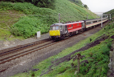 """Many a fireman would have been glad to have seen the gradient change board making the end of the gruelling 5 1/2 mile climb, 4 of those miles at 1 in 75, to Shap Summit. Today the driver of 86248 has no such worries with some 4040hp available on tap. 1S76 is 0920 from Brighton to Edinburgh, """"The Sussex Scot."""""""
