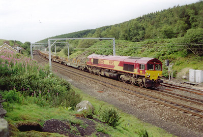 66006 reappears at Shap Summit heading south with the same P Way train it had this morning. Not only that but it has picked up another length and is twice as long.