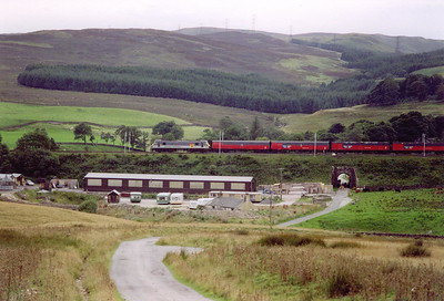 An unidentified class 90 drops down the 1 in 75 of Shap Bank southbound with 1V04 1635 Shieldmuir RMT to Bristol Parkway mail train.