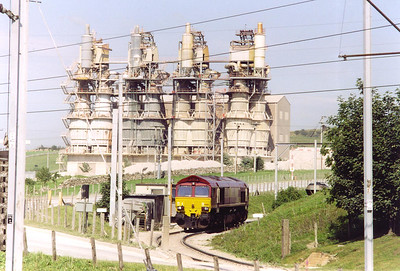 The massive stone crushers dwarf the EWS loco as it sits inside the complex.
