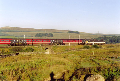 It's 07.30am and after a night in the car the warmth of the sun could be smelt on the air, a good day was in the offing. InterCity 87030 romps up Shap Bank at Salterwath as if it wasn't there with 1A33 0640 Carlisle to Glasgow Central.
