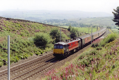 A northbound electric hauled train powers up the 1 in 75 with ease behind 86222 hauling 1S54 0550 Bournemouth to Edinburgh. The former AL6 loco would have come on at Preston replacing a Cross Country class 47.  The summit is about 3 miles away.