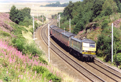A southbound mail working comes down grade behind Railfrieght Distribution 90034 with a light weight train of just four NIA vans. The working is not known for certain but is in the path of 5M89 1132 MX Motherwell TMD to Warrington RMT. This turn is booked for a Royal Mail class 325 unit which may not have been available and this is the substitute.