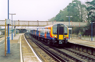 The new order for South West Trains, Desiro class 450 unit 450030 makes its station stop with a down train, 0754 SuO Waterloo to Bournemouth.