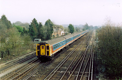 A twelve coach, 3 unit train passes heading for Basingstoke.  4VEP units 3811, 3534 and 3405 form 1G22 0745 Portsmouth Harbour to Waterloo.