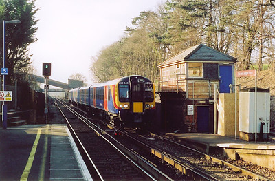 Desiro class 450 unit 450045 passes the disused ex LSWR signalbox at Botley with a stopping service 1T43 1624 SuO Eastleigh to Portsmouth Harbour.