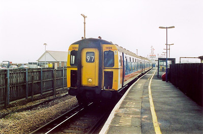 1499 stands at Lymington Pier and will return at 1114 with 2P11 SuO back to Lymington.  The journey takes 10 minutes.  The branch headcode is 97.  In the background is the ferry to Yarmouth on the Isle of Wight.