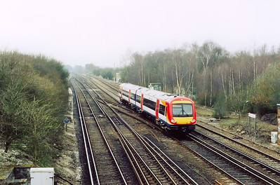 170303 has been routed onto the up fast at Worting Junction having come off Battledown Flyover.  It forms 1J14 0957 Brighton to Reading and at Basingstole it will take the left junction to head onto Reading.