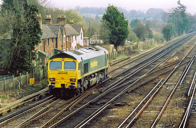 Freightliner 66519 runs east towards Basingstoke and its next job, which is not known.  Earlier it worked a train to Eastleigh Yard from Chichester, 6Z25.