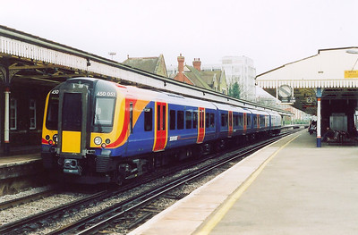 Desiron class 450 EMU 450051 makes its station stop with 1B33 1205 Waterloo to Poole.  These units are quite rapidly replacing the mkI sets.