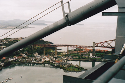 An unknown class 221 super Voyager slowly crosses the North Viaduct of the Forth Bridge with 1028 1055 SuO Aberdeen to Bournemouth Cross Country service.  This unique view is from the walkway at the top of the North Tower on the Forth Road Bridge.