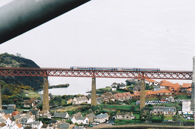 High above North Queensferry the  northbound class 158 sprinters slow for their station stop.