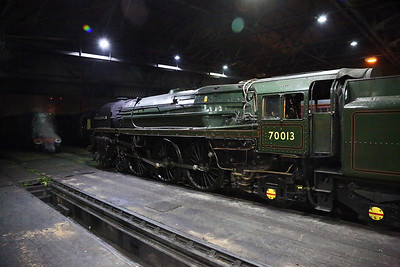 "Inside Southall shed and between trips is BR Standard Britannia class 7 70013 ""Oliver Cromwell"".  This loco is part of the National Collection.  Also visible is ""Duchess"" 46233 ""Duchess of Sutherland"" in steam."