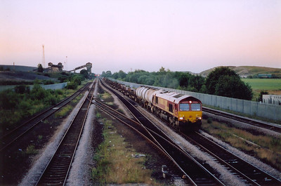 A week after the summer solstice and at 2128 hours the light is just enough to record 66225 hauling late running 6N86 1911 off Immingham to Tyne Yard Enterprise working.  27/6/2005