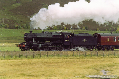 Dalwhinnie is a few miles away to the south and the road and railway come close togther. The driver is a ScotRail man and the inspector is Peter Kirk.
