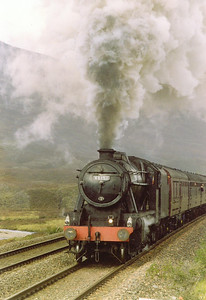 A stirring sight and sound as the 8F tears into the pull to Druimuachdar Summit 1,484 feet above sea level. Those gathered at the summit were blessed with a break in the clouds and the train passed in full sun.