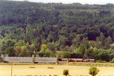 The train lost even more time when the driver stopped for a blow up south of Dunkeld due to over firing. 75014 emerges from the Tay Viaduct at Dalguise and runs over the flood plain on an embankment.