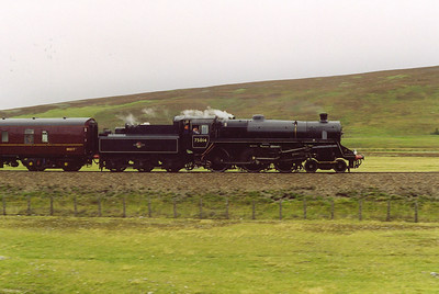 After a stop at Dalwhinnie to change firemen, the train sets off again. The line to the north of Dalwhinnie descends at 1 in 100 for several miles.   Inspector Peter Kirk sits in the firemans seat and watches the road ahead.