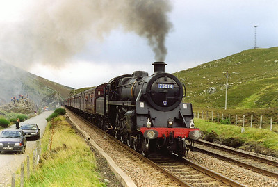 What a sight, a Standard class 4, 4-6-0 locomotive tops Slochd Summit at 1,315 feet, in stunning style. Fireman Stevie Fraser has done a great job in working the loco from Dalwhinnie and the sound of his efforts was music to the ears of the gathered photographers.