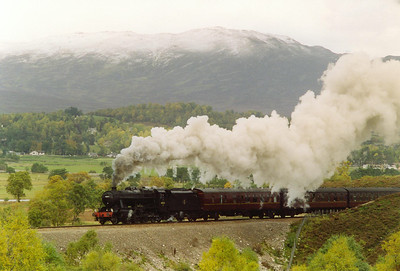 The snow capped Carn Moirg forms the backdrop as 48151 climbs past Raliabeag, south of Newtonmore, at 1 in 95. It is uphill for 15 miles, bar two very short level sections, on the climb to Druimuachdar.
