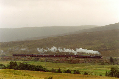 "The 15 mile climb from Blair Athol north was known as ""The Hill"" by footplate crews. Here 75014 digs into the climb on Struan Bank for the long hard slog to the summit most of it at 1 in 70."