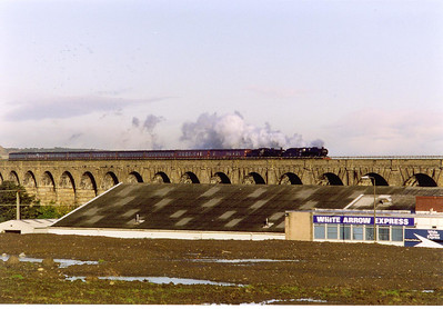 Time to go home, after stabling at Bo'ness on the preserved railway, 48151 pilots 75014 on 5Z18 0841 Bo'ness to Carnforth ECS movement. It is first seen crossing the impressive 36 arch Ratho Viaduct by Newbridge Junction.  19/10/1998