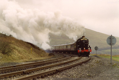 "History in the making, the first time a former Great Western Railway King class locomotive has passed over the former Midland Railway route to Carlisle via Settle. 6024 approaches Dent in fine style working ""The Regal Cumbrian Mountain"" railtour. It started in Euston with the steam coming on at Hellifield.....I think.  7/3/1998"
