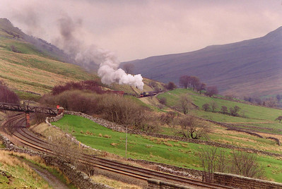 A King on Mallerstang. Could this be the first time a King has graced Mallerstang since the death of King Uther Pendragon (AD 410 - 495, King Arthur's father) who's castle lies in ruins a few miles away. 6024 wrestles its 13 bogie load up the 1 in 100 pull to Ais Gill summit.