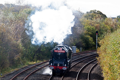 The signal ahead is at red but the driver has steam on to get the loco up to the signal.