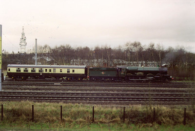 The steam loco came off at Carlisle station with electric traction back to London. Here the 6024 and its support coach arrive at Upperby depot to back into the shed sidings to be disposed. It would have turned via reversing back down to London Road junction and coming back up the north to east line.  7/3/1998