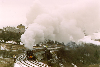 On a bitterly cold day, 44767 passes by to the south of Inverkeithing with the first of two round trips of the Fife Circle out and back from Edinburgh.  1/1/1997