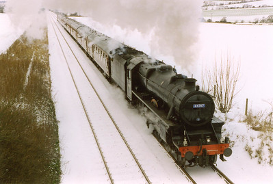 An overnight fall of snow just adds to the scene as 44767 climbs towards Dalgety Bay at a gradient of 1 in 92 1/2. The loco took water at Inverkeithing station so there was no chance of a run at the bank.