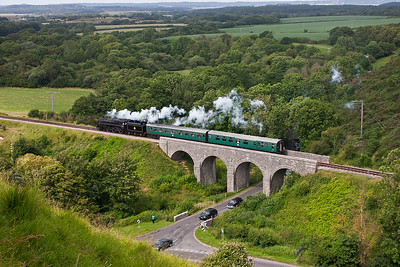 The class 5 loco with Caprotti valve gear passes over the viaduct over the Studland road.