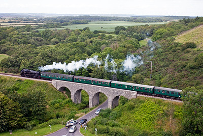80078 has steam on as it passes over Corfe Viaduct on the rising 1 in 264 gradient.  Its train is 2N20 1510 from Swanage to Norden.