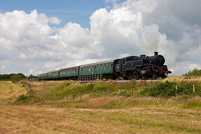 Standard 4 tank engine 80078 reappears from the short cutting at Afflington bridge working 2S13 1350 Norden to Swanage.