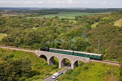 The short train crosses Corfe viaduct which was once obscured by trees.