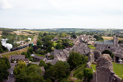 Another look at the village seen from the eastern flank of Corfe Castle and Bulleid 34081 lifts its five coach Norden train away from the station. The train is 2N24 1630 from Swanage.