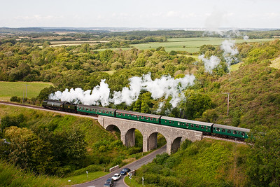 A patch of sunlight catches the train as it crosses Corfe Viaduct.