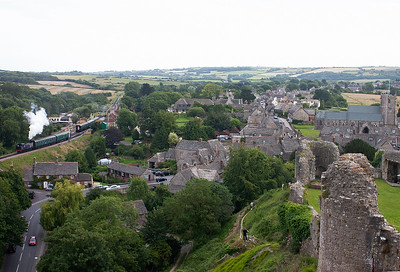 A panoramic view of Corfe Castle village and how the station nestles on the eastern flank of the village. 30053 departs with 2N23 1625 from Harmans Cross to Norden.