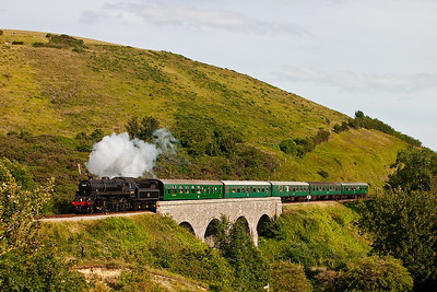 In lovely late afternoon sunlight, 76079 brings its Norden train over Corfe Viaduct with 2N26 1710 off Swanage.