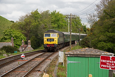 A timeless scene that could be taken in the early 1960's.  Two tone BR green class 47 1842 approaches with 2N03 1000 fro Norden to Swanage.