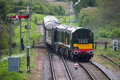 Entering the station loop is a pair of BR green English Electric type 1 locos D8188 and D8059 with a class 1 working to the Eastern Region according to the headcode.