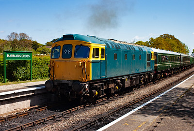 On the back of the shuttle service is 33111 in BR blue but without its running number as the loco is still being worked on but is in running order. It departs back to Norden as 2N08 1145 off. Note the 98 headcode, this was the two digit headcode for the Swanage Branch.
